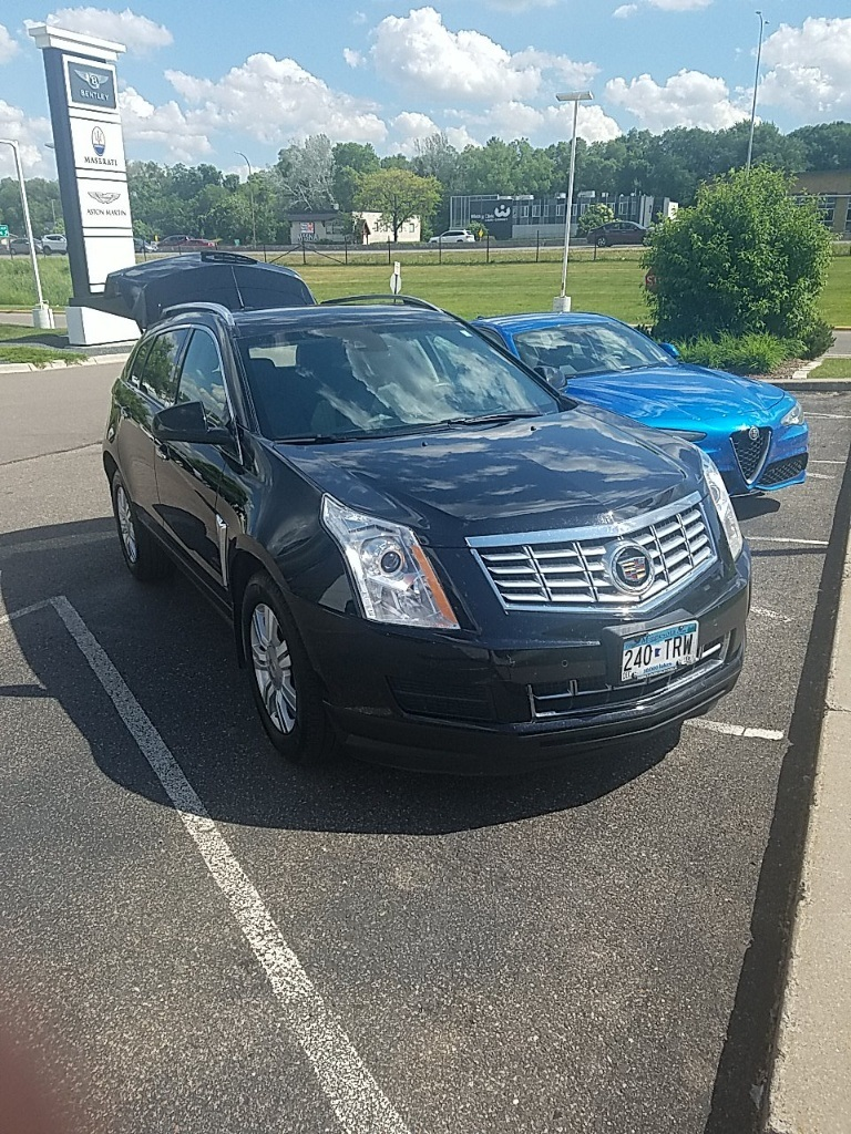 Pre owned 2015 cadillac srx luxury awd